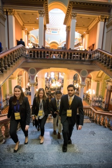 Students walking up stairs group Capitol vertical.JPG